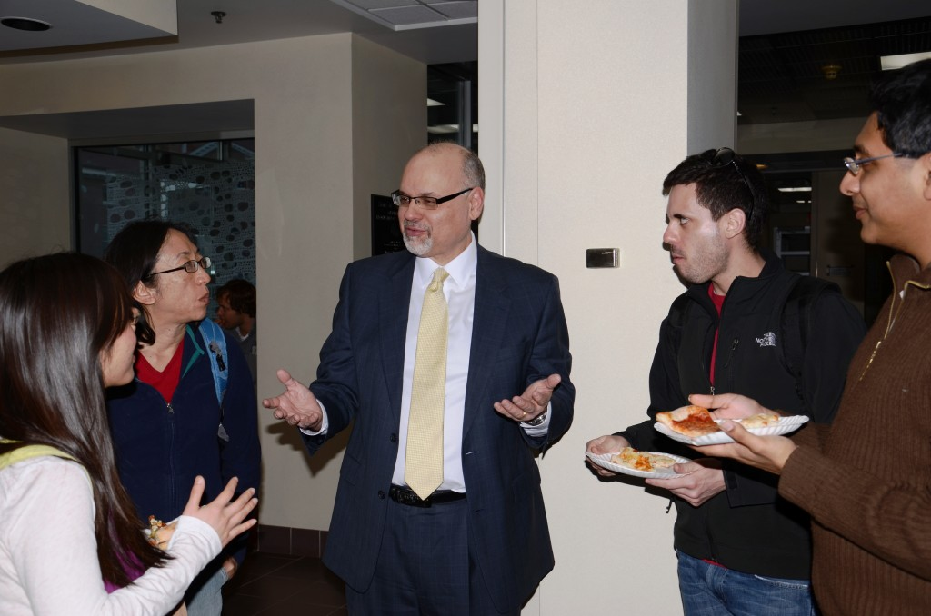 Perlmutter talks with some UW students.